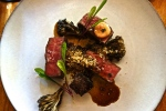 Wood-Roasted Ribeye with Mushrooms, Amaranth and Dandelion Greens